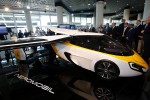 People look at the AeroMobil flying car during its unveiling at the Top Marques Monaco supercar show in Monaco